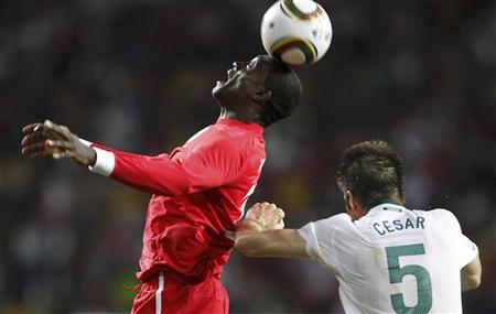 England's Emile Heskey heads the ball nest to Slovenia's Bostjan Cesar during the 2010 World Cup Group C soccer match in Port Elizabeth June 23, 2010. REUTERS/Darren Staples