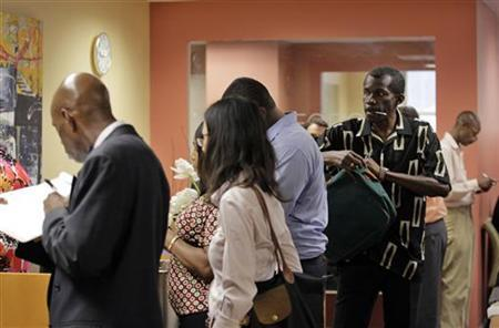 People wait in line to meet with job counselor during a job fair at Workforce1 in New York September 6, 2012. Workforce1 is a service provided by the New York City Department of Small Business Services that prepares and connects candidates with job opportunities in the city. REUTERS/Brendan McDermid