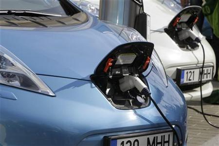 Nissan Leaf electric cars are being charged before the start of an electric car rally from Tallinn to Monte-Carlo in Tallinn June 1, 2012. REUTERS/Ints Kalnins