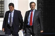 Greece's Prime Minister Antonis Samaras (R) leaves his office after a meeting with the government's coalition party leaders in Athens September 20, 2012. Greece's latest round of talks with lenders on an austerity plan was marked by moments of tension as the two sides squabbled over a plan to reform the country's bloated public sector, government officials told Reuters on Thursday. REUTERS/John Kolesidis
