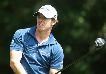 Rory McIlroy of Northern Ireland hits off the third tee during the first round of the Tour Championship golf tournament at the East Lake Golf Club in Atlanta, Georgia, September 20, 2012. REUTERS/Tami Chappell