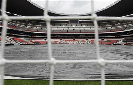 The soccer field is covered with a rain tarp at the Azteca stadium in Mexico City September 10, 2012. REUTERS/Henry Romero