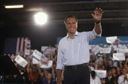 U.S. Republican presidential nominee and former Massachusetts Governor Mitt Romney acknowledges the applause of the crowd at a campaign rally in Miami, Florida, September 19, 2012. REUTERS/Jim Young