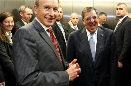 U.S. Secretary of Defense Leon Panetta (2nd R) laughs with staff members in an elevator after presenting medals to New Zealand Defence Force Service members for their service in Afghanistan, at the Auckland War Memorial Museum in Auckland September 21, 2012. REUTERS/Larry Downing