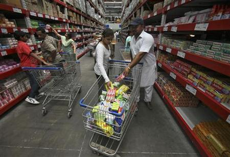 Customers shop at a Best Price Modern Wholesale store, a joint venture of Wal-Mart Stores Inc and Bharti Enterprises, in Zirakpur in the northern Indian state of Punjab June 8, 2012. REUTERS/Ajay Verma/Files