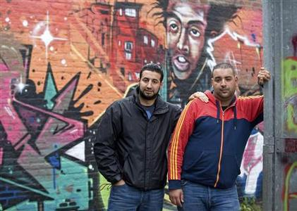 Youth worker Mostafa Ameziane (L), 31, and unemployed Hamza Ahmadoun, 25, pose for a photograph in Antwerp June 13, 2012. REUTERS/Eric Vidal