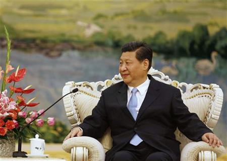 China's Vice President Xi Jinping listens to U.S. Secretary of Defense Leon Panetta (not pictured) in a meeting at the Great Hall of the People in Beijing, September 19, 2012. REUTERS/Larry Downing