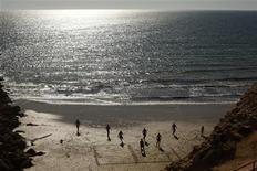 Boys play soccer on hot summer day at La Victoria beach in Cadiz, southern Spain August 28, 2012. REUTERS/Jon Nazca