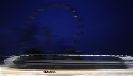 Red Bull Formula One driver Sebastian Vettel of Germany drives during the first practice session of the Singapore F1 Grand Prix at the Marina Bay Street Circuit September 21, 2012. REUTERS/Tim Chong