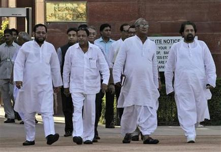 (Front L - R) Indian ministers Sultan Ahmed, Mukul Roy, Saugata Roy and Sudip Bandyopadhyay walk at the forecourt of India's presidential palace Rashtrapati Bhavan after their meeting with India's President Pranab Mukherjee in New Delhi September 21, 2012. REUTERS/B Mathur