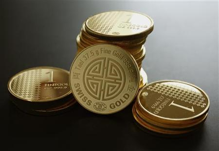 A China Gold Tael (37.5 gram) along with other one-ounce gold coins are displayed in this illustration photo in Hong Kong June 20, 2012. REUTERS/Bobby Yip/Files