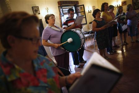 Pensioners rehearse songs at a seniors centre in Ronda, near Malaga September 18, 2012. REUTERS/Jon Nazca