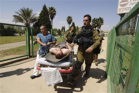 A wounded Israeli soldier is wheeled into Soroka hospital in the southern city of Beersheba September 21, 2012. REUTERS/Dudu Grunshpan