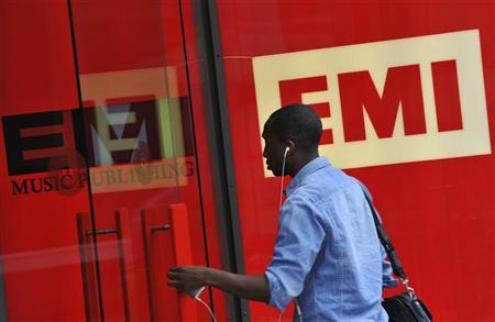 A man enters EMI offices in west London August 18, 2010. EMI's parent company said on Wednesday further equity injections may be needed, particularly in 2011, as the music group continues to struggle under the weight of its debt in spite of an improved trading performance. REUTERS/Toby Melville