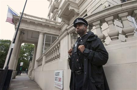 A police officer stands guard outside the French embassy in central London September 20, 2012. REUTERS/Neil Hall