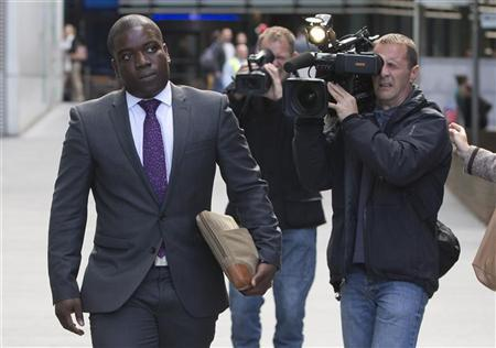 Former UBS trader Kweku Adoboli leaves Southwark Crown Court in London September 14, 2012. REUTERS/Neil Hall