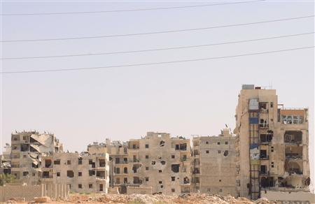 Damaged buildings are seen at Saladin neighbourhood after clashes between Free Syrian Army fighters and forces loyal to President Bashar al-Assad in Aleppo city September 21, 2012. REUTERS/George Ourfalian