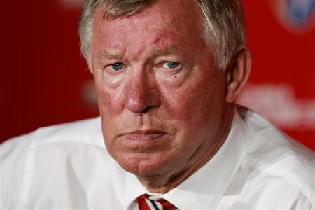 Manchester United's coach Alex Ferguson attends a news conference after a friendly soccer match against Shanghai Shenhua at the Shanghai Stadium in Shanghai, July 25, 2012. REUTERS/Aly Song