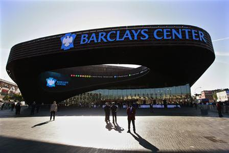 People arrive for the ribbon cutting ceremony at the Barclays Center in the Brooklyn borough of New York September 21, 2012. The Frank Gehry designed Barclays Center is home to the NBA's Brooklyn Nets and will officially open with a concert by Brooklyn native Jay-Z on September 28. REUTERS/Brendan McDermid