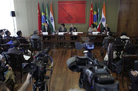 Brazil's Foreign Minister Antonio Patriota (back C) speaks during a news conference after the II Ministerial coordination between Brazil, South Africa, India and China (BASIC) on the ongoing negotiations under the Convention United Nations Framework Convention on Climate Change (UNFCCC), at the Itamaraty Planalto in Brasilia September 21, 2012. REUTERS/Ueslei Marcelino