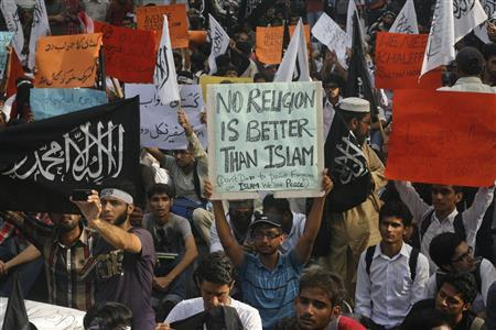 Protesters hold placards while they take part in an anti-American demonstration during a protest rally in Lahore on September 20, 2012. REUTERS/Mohsin Raza