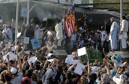 Afghan protesters set fire to a U.S. flag as they shout slogans during a demonstration in Kabul, September 21, 2012. Hundreds of Afghans protested against a U.S.-made film they say insults the Prophet Mohammad. REUTERS/Omar Sobhani