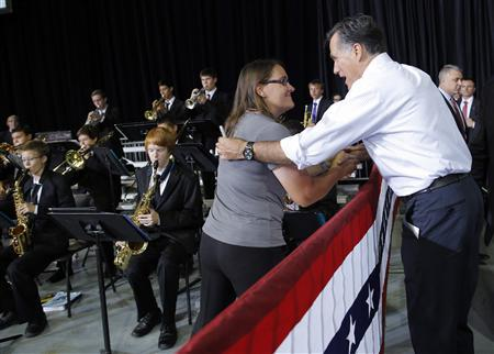 Republican presidential candidate and former Massachusetts Governor Mitt Romney thanks a representative from the Palo Verde High School band as they played at a campaign rally in Las Vegas, Nevada September 21, 2012. REUTERS/Brian Snyder