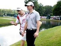 Rory McIlroy of Northern Ireland (R), talks with his caddie JP Fitzgerald (L), as they walk to the seventh green during the second round of the Tour Championship golf tournament at the East Lake Golf Club in Atlanta, Georgia, September 21, 2012. REUTERS/Tami Chappell