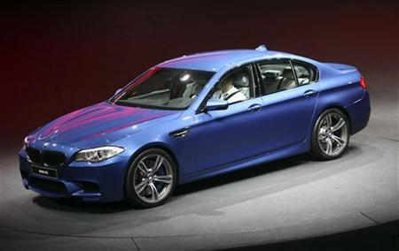 German luxury carmaker BMW presents the company's new M5 series during the International Motor Show (IAA) in Frankfurt, September 13, 2011. REUTERS/Ralph Orlowski