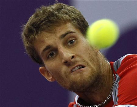 Martin Klizan of Slovakia returns the ball to Mikhail Youzhny of Russia during their semi-final match at the St. Petersburg Open tennis tournament in St. Petersburg September 22, 2012. REUTERS/Alexander Demianchuk