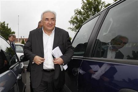 Former IMF head Dominique Strauss-Kahn arrives at a polling station in the second round of the 2012 French presidential elections in Sarcelles May 6, 2012. REUTERS/Gonzalo Fuentes
