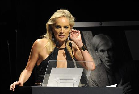 U.S. actress Sharon Stone attends an auction at a charity dinner for The Foundation for AIDS Research (amfAR) during Milan's Fashion Week September 22, 2012. REUTERS/ Paolo Bona