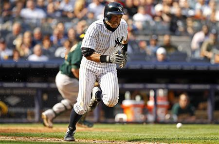 New York Yankees Ichiro Suzuki runs up the first baseline after laying down a sacrifice bunt against the Oakland Athletics during the sixth inning of their MLB American League baseball game at Yankee Stadium in New York September 22, 2012. REUTERS/Adam Hunger