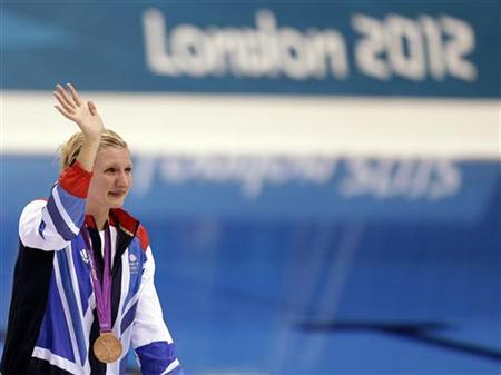 Bronze medallist Britain's Rebecca Adlington waves to the crowd at the women's 800m freestyle victory ceremony during the London 2012 Olympic Games at the Aquatics Centre August 3, 2012. REUTERS/Tim Wimborne