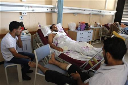 An injured man, one of the demonstrators involved in the attack of pro-government Rafalla al-Sihati brigade base, receives medical treatment at a hospital in Benghazi September 22, 2012.REUTERS/Asmaa Waguih