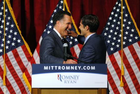 Republican presidential candidate and former Massachusetts Governor Mitt Romney is introduced by his son Matt (R) at a campaign fundraiser in Del Mar, California September 22, 2012. REUTERS/Brian Snyder