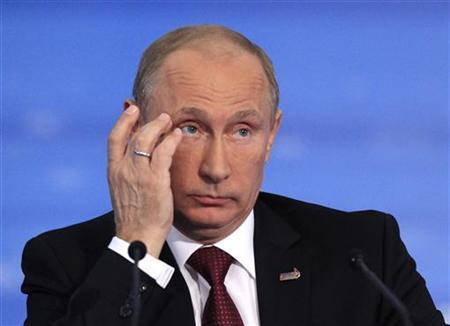 Russia's President Vladimir Putin attends a news conference at the Asia-Pacific Economic Cooperation (APEC) Summit in Vladivostok September 9, 2012. REUTERS/Sergei Karpukhin