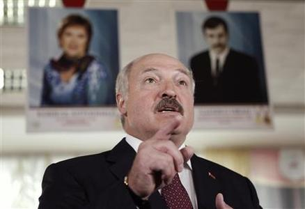 Belarusian President Alexander Lukashenko speaks with the media during the parliamentary election at a polling station in Minsk, September 23, 2012. REUTERS/Vasily Fedosenko