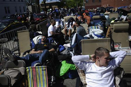 Jobseekers wait in front of the training offices of Local Union 46, the union representing metallic lathers and reinforcing ironworkers, in the Queens borough of New York, in this April 29, 2012 file photograph. REUTERS/Keith Bedford/Files