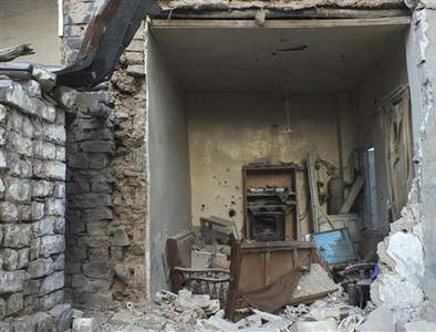 A view of a damaged house in the city of Homs September 22, 2012. REUTERS/Yazen Homsy