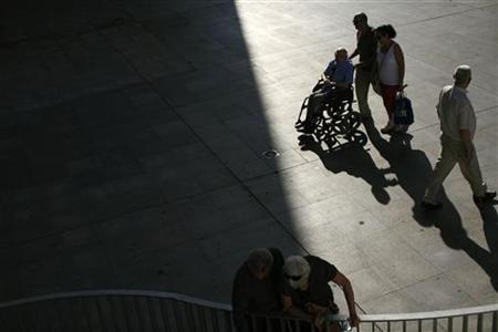 A pensioner sits in a wheelchair in the Andalusian capital of Seville September 20, 2012. REUTERS/Marcelo del Pozo