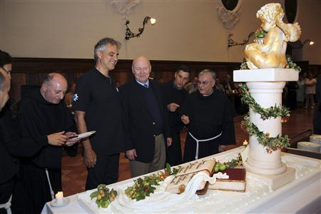 Italian tenor Andrea Bocelli celebrates his 54th birthday with Franciscan monks in Assisi September 22, 2012. REUTERS/ Franciscan Handout