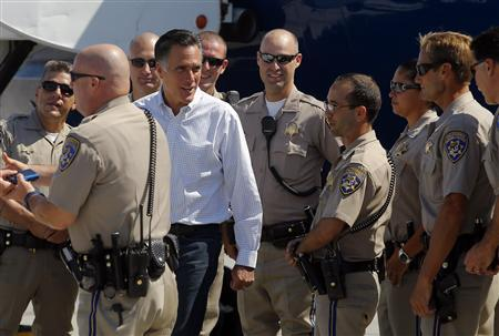 Republican presidential candidate and former Massachusetts Governor Mitt Romney greets the police officers who accompanied his motorcade to the airport in Los Angeles, California September 23, 2012. REUTERS/Brian Snyder