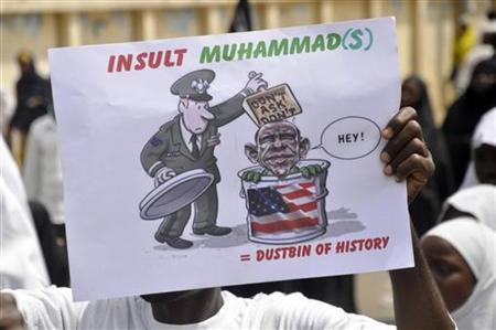 A Muslim demonstrator holds a placard during a protest to denounce an anti-Islam film made in the U.S. mocking Prophet Mohammad at Kofar Kwaru district in Nigeria's northern city of Kano September 22, 2012. REUTERS/Mohammed Giginyu
