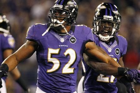 Baltimore Ravens linebacker Ray Lewis (52) restrains teammate Lardarius Webb (R) as he complains about a penalty call during the second half of their NFL football game against the New England Patriots in Baltimore, Maryland, September 23, 2012. REUTERS/Jonathan Ernst