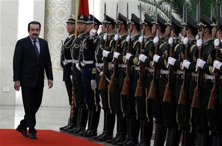 Kazakhstan's Prime Minister Karim Masimov (L) inspects an honour guard during an official welcoming ceremony in the Great Hall of the People in Beijing March 31, 2012. REUTERS/David Gray