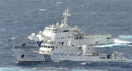 An aerial photo shows a Chinese marine surveillance ship Haijian No. 66 (front) cruising next to a Japan Coast Guard patrol ship in the East China Sea, known as Senkaku isles in Japan and Diaoyu islands in China, in this photo by Kyodo September 24, 2012. REUTERS/Kyodo