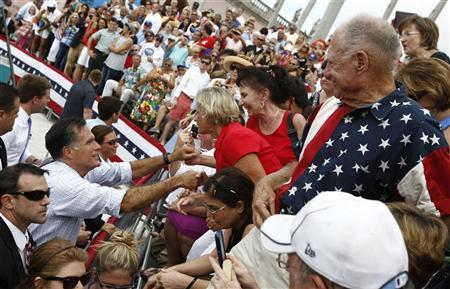 U.S. Republican presidential nominee and former Massachusetts Governor Mitt Romney greets supporters at a campaign rally in Sarasota, Florida, September 20, 2012. REUTERS/Jim Young