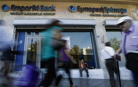 A boy plays an accordion outside of an Emporiki bank branch in central Athens September 21, 2012. REUTERS/John Kolesidis