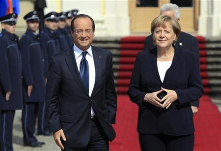 France's President Francois Hollande (L) and Germany's Chancellor Angela Merkel arrive for the 50th anniversary ceremony of the reconciliation speech of France's President Charles de Gaulle to the Germany youth after World War II, in castle Ludwigsburg September 22, 2012. REUTERS/Michaela Rehle